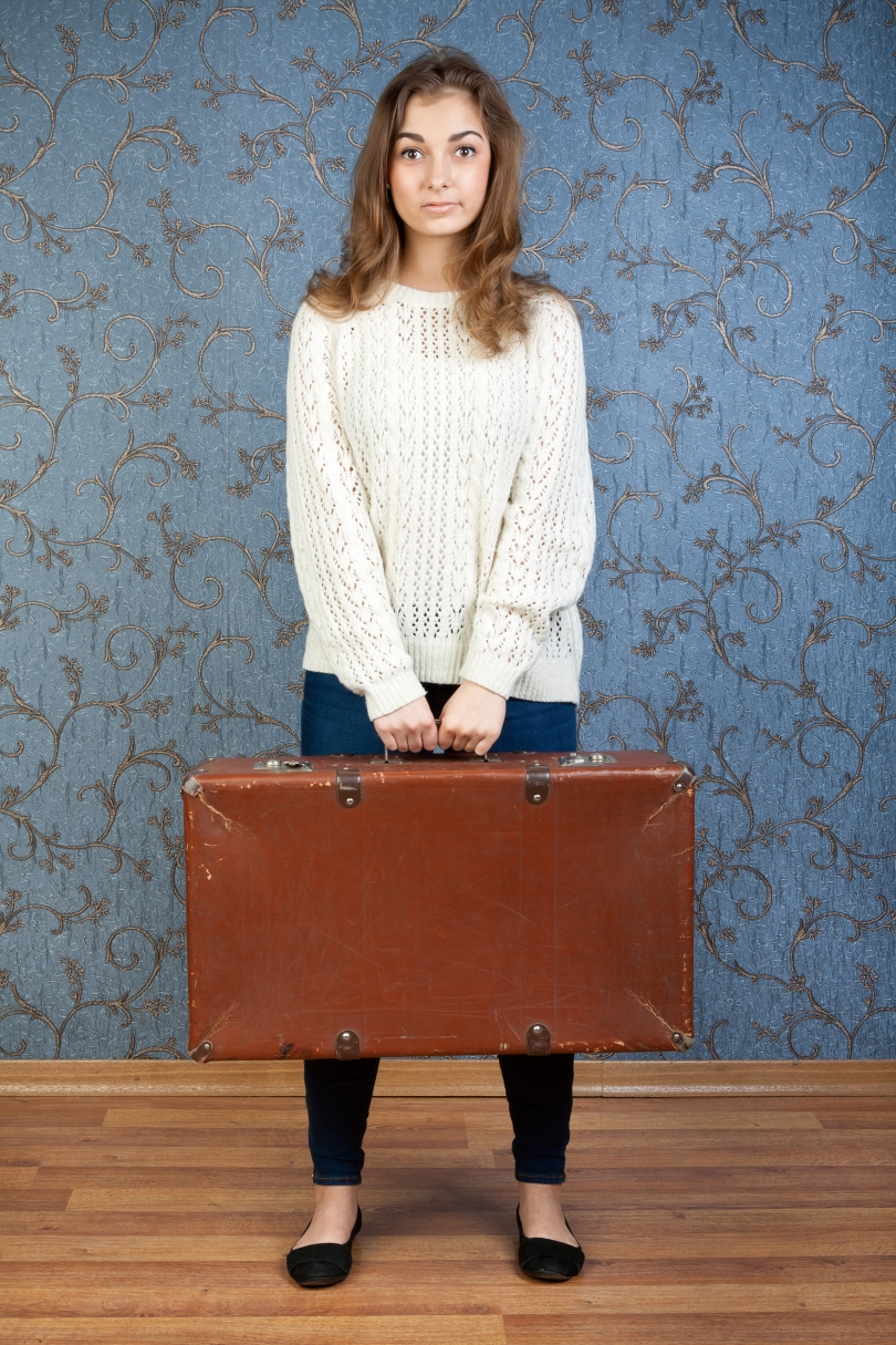 portrait of a beautiful girl with a suitcase