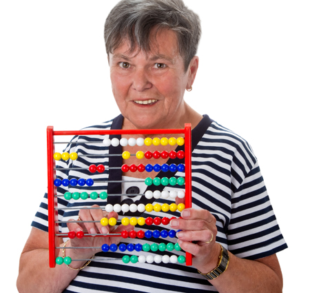 Senior woman calculating on abacus - isolated