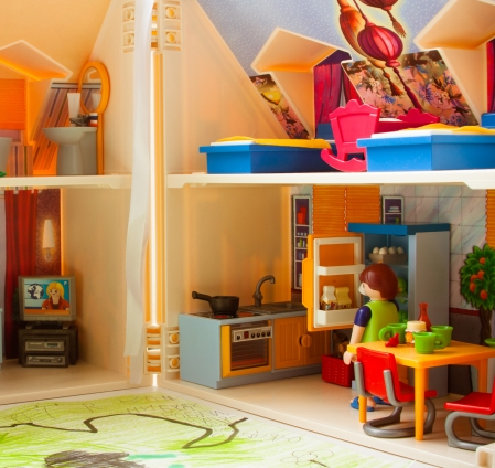 Plastic doll house with a doll family inside