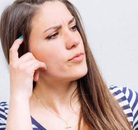 Worried woman tries to remember something