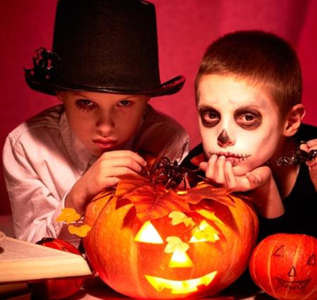 Photo of twin eerie boys looking at camera in dark